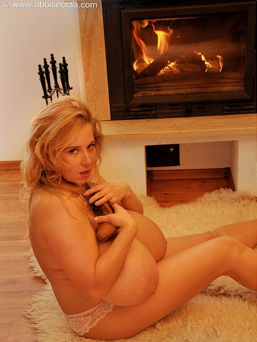 Abbi Secraa in front of the fireplace